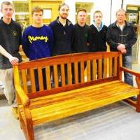 The team at Camelia Botnar Foundation's Carpentry Department with the finished bench.